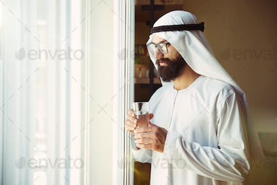 Arabian saudi businessman working in office