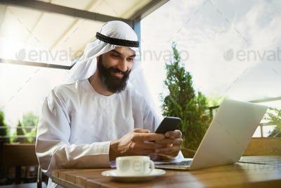 Arabian saudi businessman working outdoors