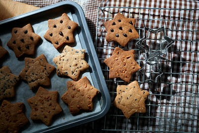 Homemade star shape cookies on baking tray