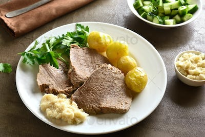 Boiled beef with potatoes and horseradish