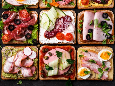 open sandwiches with different meat, top view