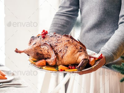 roast duck in female hands