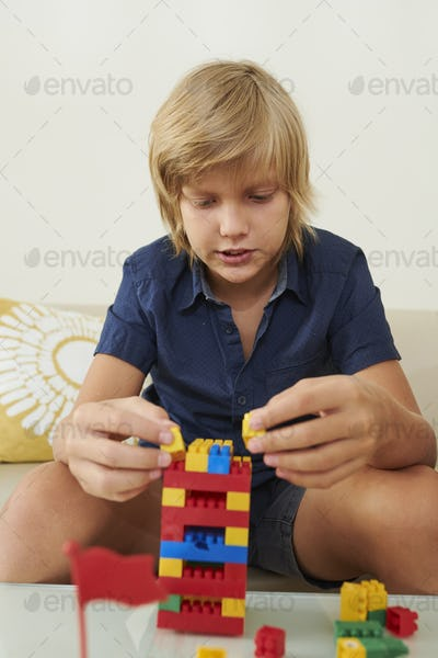 Boy playing with colorful toy blocks