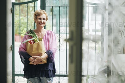 Elderly woman with bag of groceries