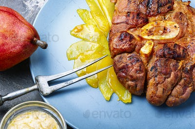 Grilled beef steaks with pear