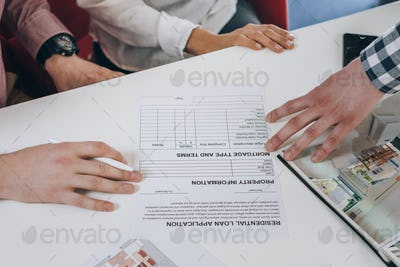 Real Estate Agency. Young Couple Signing Financing Contract