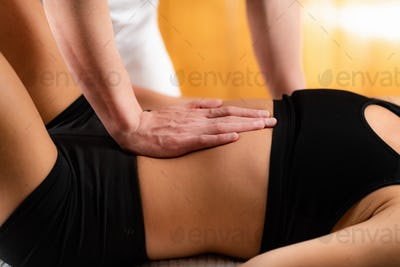 Osteopath working with patient