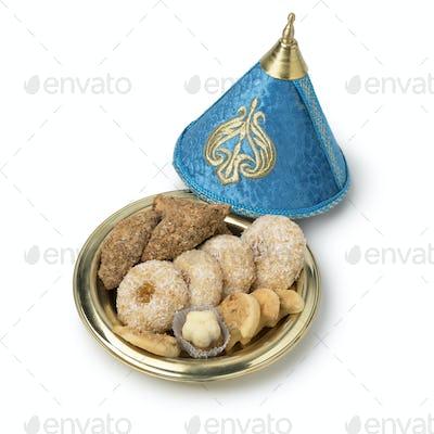 Traditional Moroccan cookies in a festive tajine
