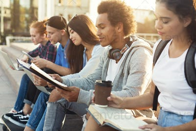 Teenage Diverse Students Studying Outdoors in Evening