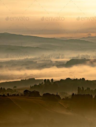 Foggy Sunrise over tuscan Hills