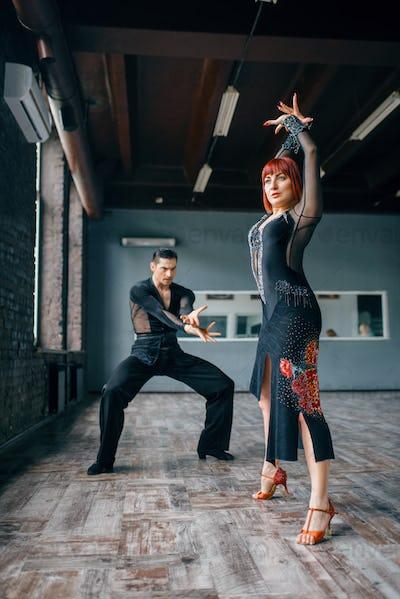 Elegance couple on ballrom dance training in class