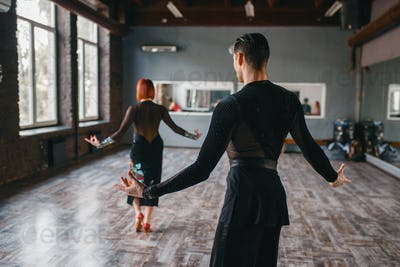 Man and woman on ballrom dance training in class