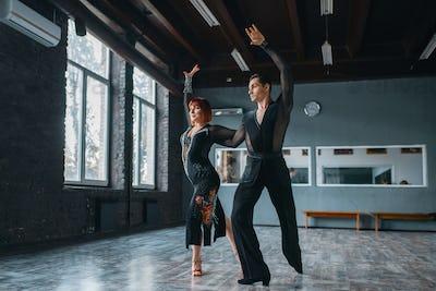 Elegance man and woman on ballrom dance training