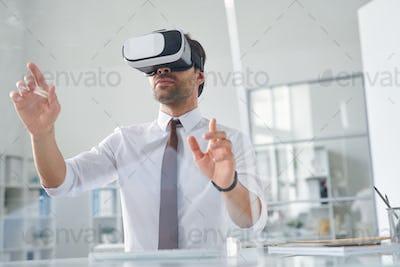 Contemporary young businessman making virtual presentation
