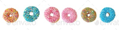 Doughnuts with colorful decoration isolated on white color background. Top view