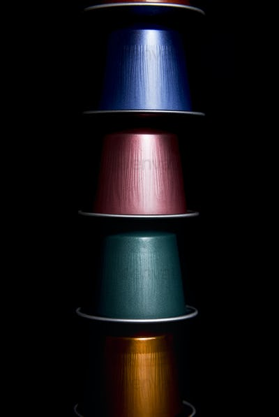 close up of a group of colored coffee capsules arranged on top of each other