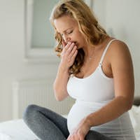 Portrait of blonde pregnant woman feeling sick