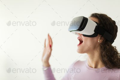 Beautiful woman virtual trying reality glasses at home