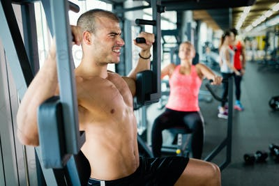 Attractive man and beautiful woman workout in gym