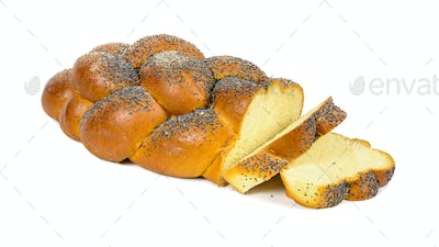Sliced challah bread on white background