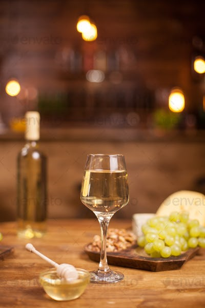 Wine tasting in a vintage pub with fresh grapes on a wooden table