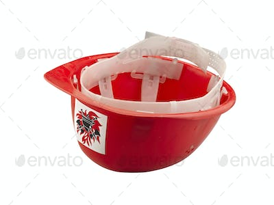 Red plastic safety  fireman helmet on white background