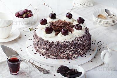 Black Forest Cake, Schwarzwald Pie, Dark Chocolate and Cherry Dessert on a White Wooden Background.