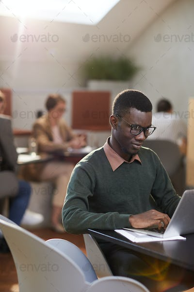 Young African-American Man Working in Cafe
