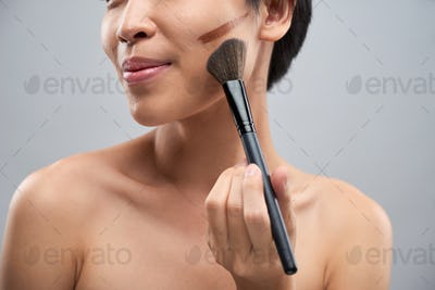 Woman correcting her face