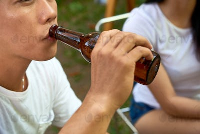 Man drinking beer outdoors