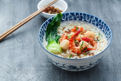 Rice noodle soup with seafood and chicken broth