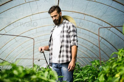 Young farmer protecting his plants