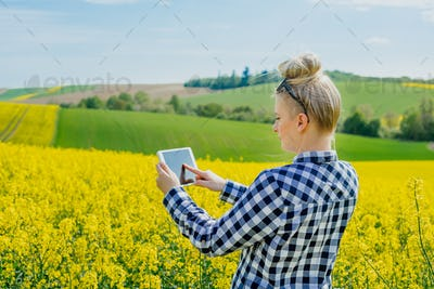 Agriculture Farmer Using Digital Tablet Examining Crops