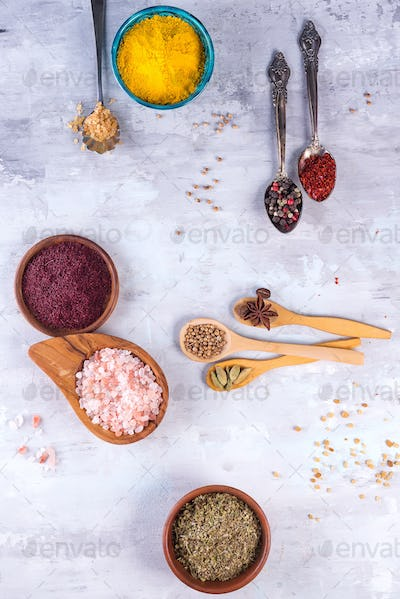 Dried herb and spice food in spoons and bowls