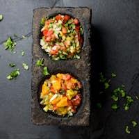 Mexican sauces - pico de gallo, salsa bandera mexicana in stone mortars