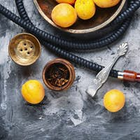 Smoking arab hookah with apricots