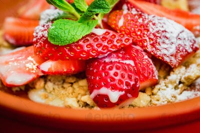 Close up strawberry dessert with cookie crumbles