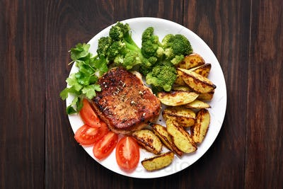 Grilled meat with vegetables, top view