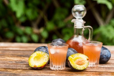 Plum brandy or slivovitz with fresh ripe plums