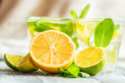 Lemonade or mojito cocktail with lemon and mint