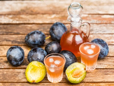 Plum brandy or slivovitz with fresh ripe plums