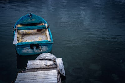 Small blue wooden rowing fisherman boat