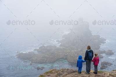 Family admiring landscape of the Lands End