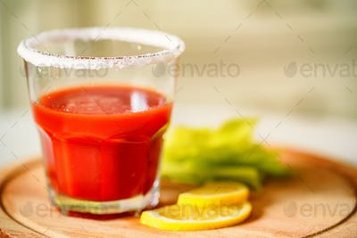 Bloody Mary alcoholic drink with lemon and celery