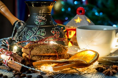 Cozy winter setting with cup of coffee and cezva