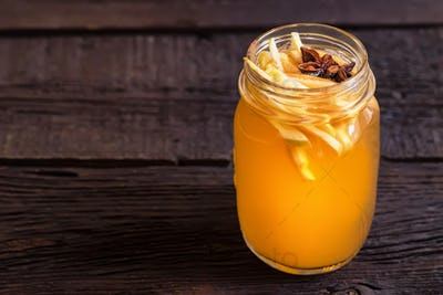 Close up glass jar with delicious healthy apple punch