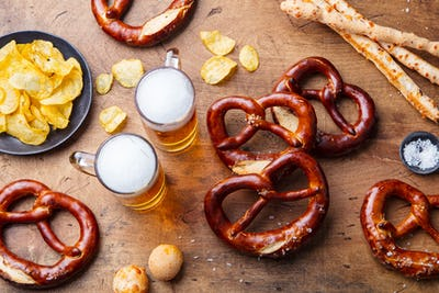 Beer, Salted Pretzels on Wooden Table Background. Top view.