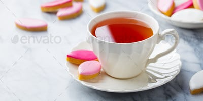 Cup of Tea with Calissons, Traditional French Provence Sweets on Marble Background. Copy Space.