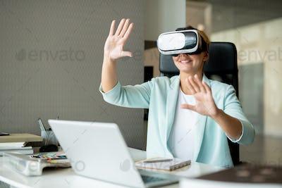 Young successful designer watching virtual presentation