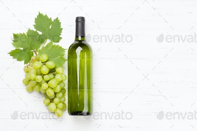 White wine bottle and grape